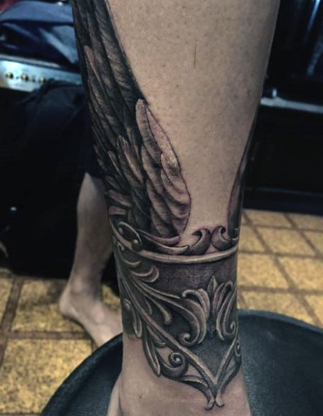 Mens Wing Tattoos On Lower Legs