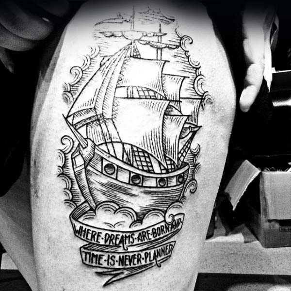 Mens Woodcut Thigh Tattoo Of Sailing Ship With Scroll