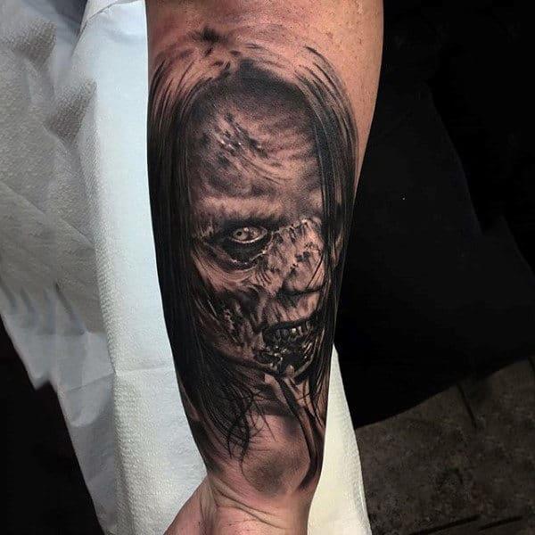 Mens Wrist Tattoo Of Woman With Zombie Virus