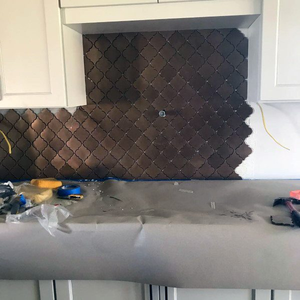 Metal Backsplash Dark Copper Pattern With White Kitchen Cabinets