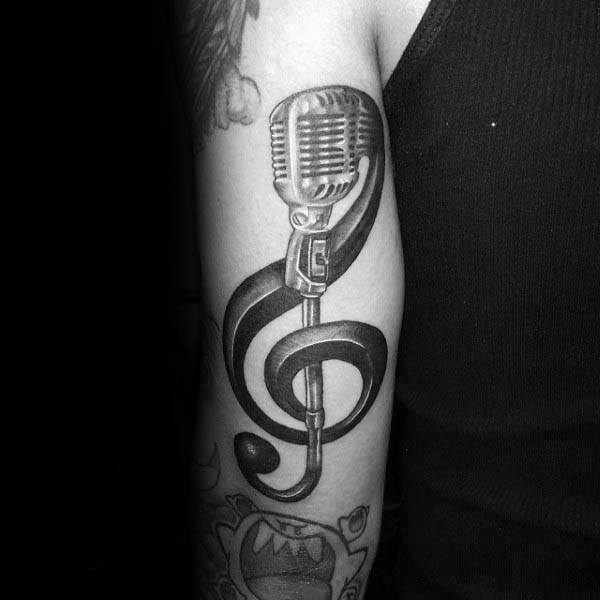 Microphone Treble Clef Male Back Of Arm Tattoo
