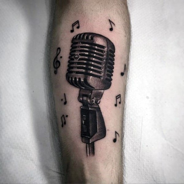 Microphone With Musical Notes Tattoo On Forearm