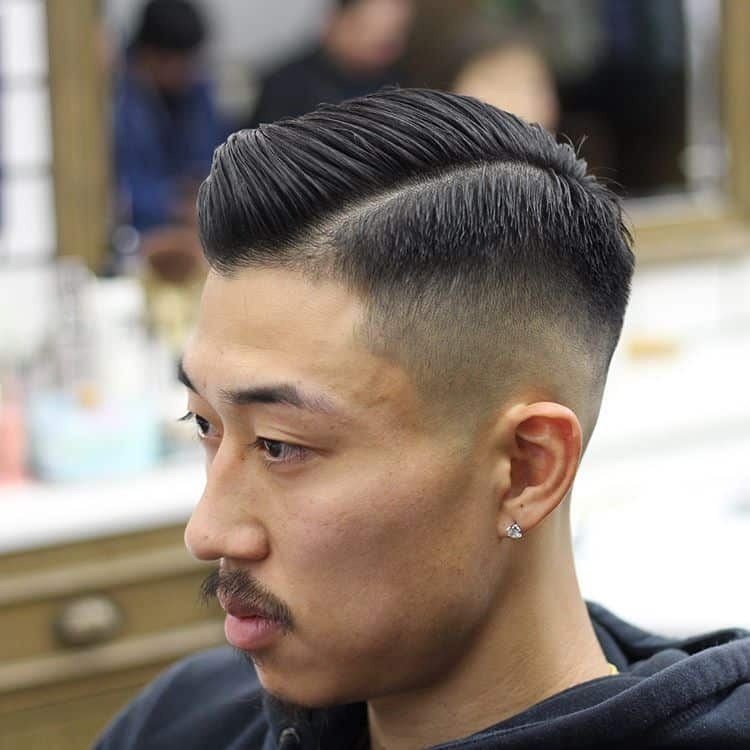 A haircut with front-swept manes and medium fade sides and back