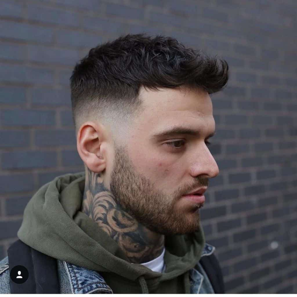 Wavy texture hair on top and mid faded sides and back