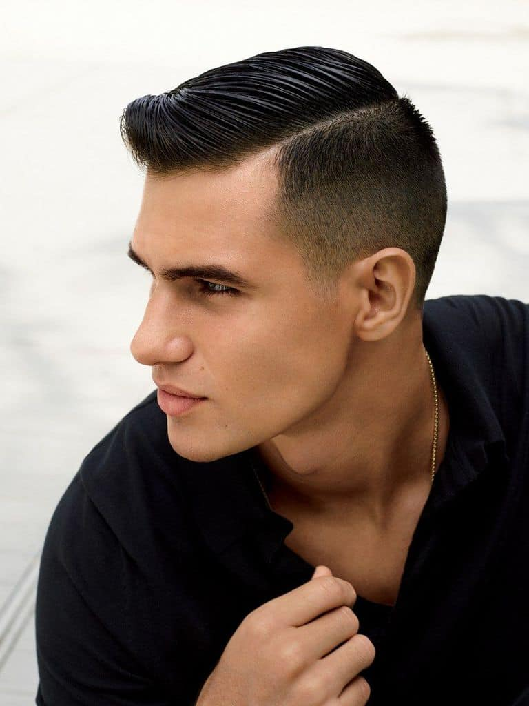 A mod fade haircut with lightly long hair on top and short sides and back