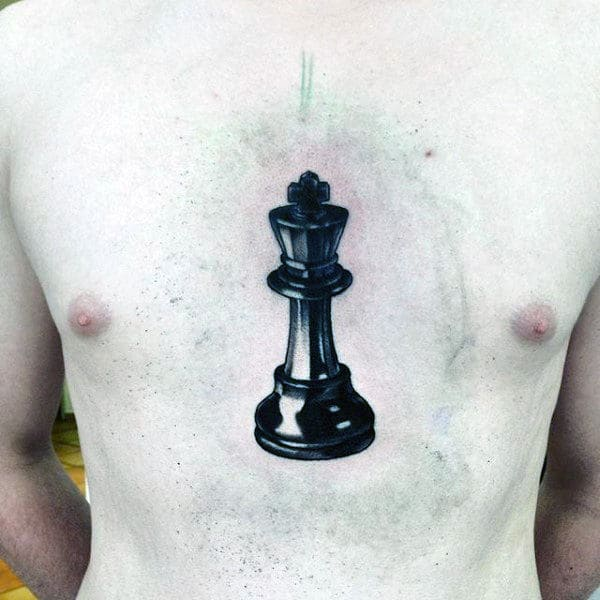 Middle Of Chest Black Ink King Chess Piece Guys Tattoos