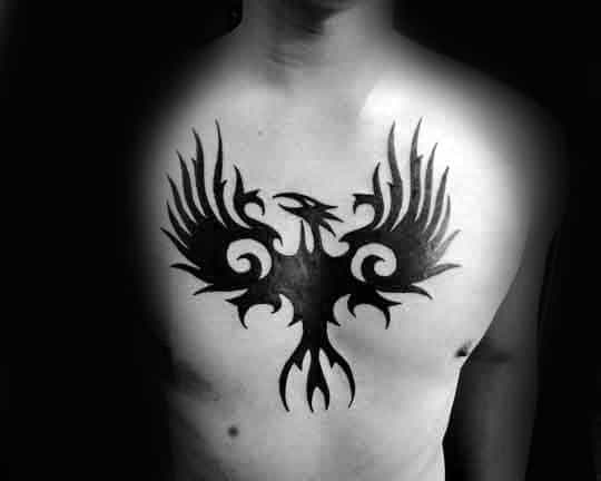 Middle Of Hest Tribal Eagle Tattoo On Man