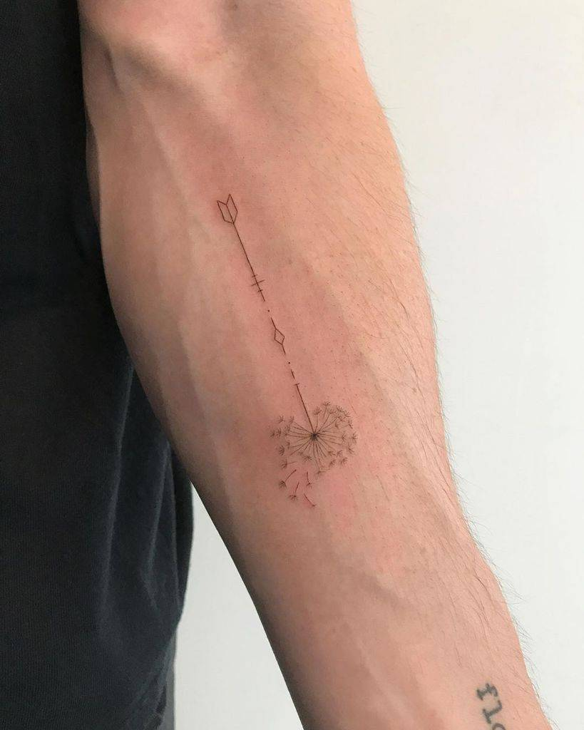 minimal arrow dandelion tattoo
