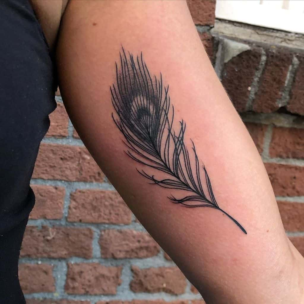 Minimal Peacock Feather Tattoo