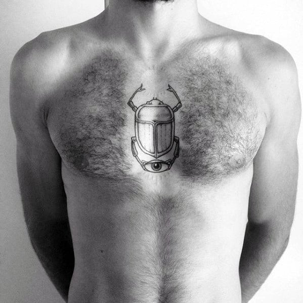 minimalistic scarab mens chest tattoo