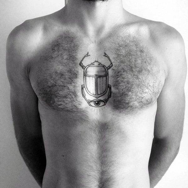 minimalistic scarab mens chest tattoo