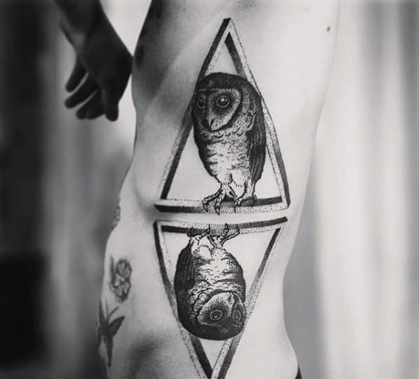 Mirror Image Of Owl In Triangle Tattoo On Ribs For Men