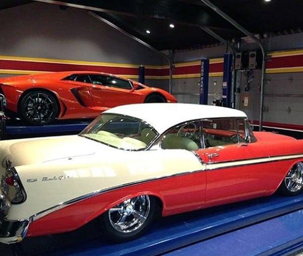 Modern Lamborgini And Old School Vintage Classic Car In Dream Garage