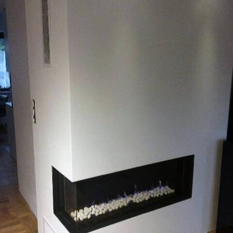 Modern Minimalistic Corner Fireplace Design With White Stones