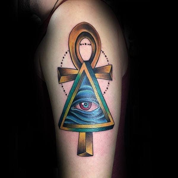 Modern New School Ankh With All Seeing Eye Tattoo On Mans Upper Arm