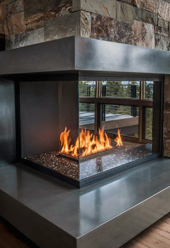Modern Polished Concrete And Glass Corner Fireplace Design