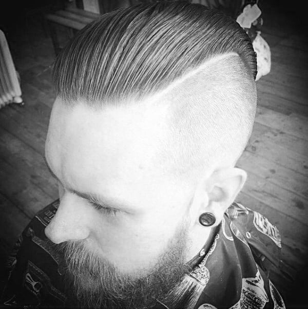 Modern Slicked Back Undercut Haircut For Males With Beards