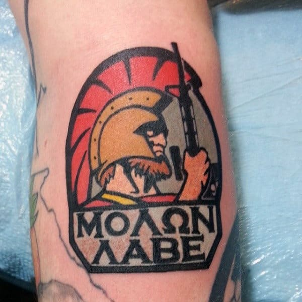 Modern Small Molon Labe Man Holding Rifle Tattoo On Arm