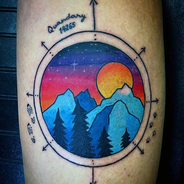 Modern Style Simple Compass And Mountain At Sunset Tattoo On Forearm On Man