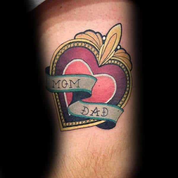 Mom And Dad Memorial Heart Tattoo With Decorative Design On Males Arm