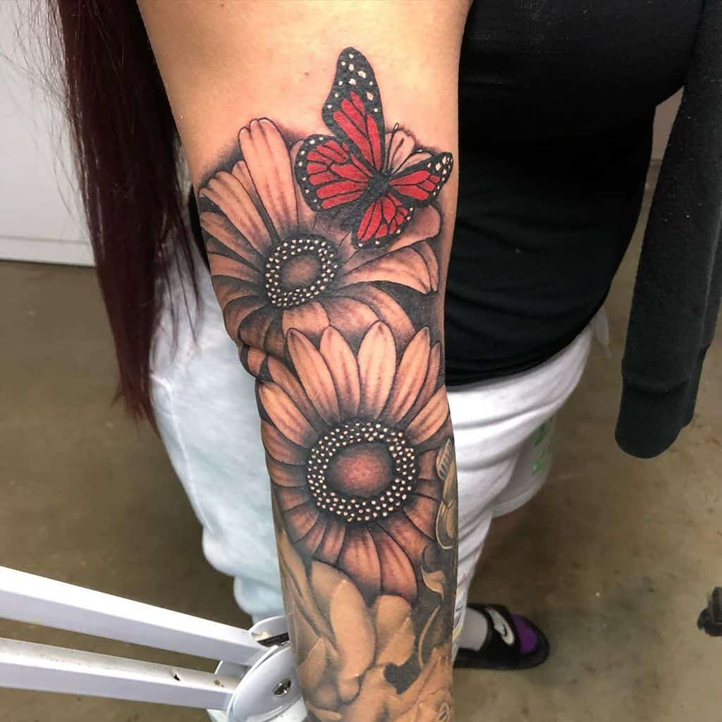 Forearm tattoo realistic color monarch butterfly and daisy