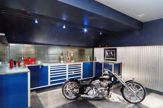 Motorcycle Garage With Blue Storage Cabinets And Led Lights