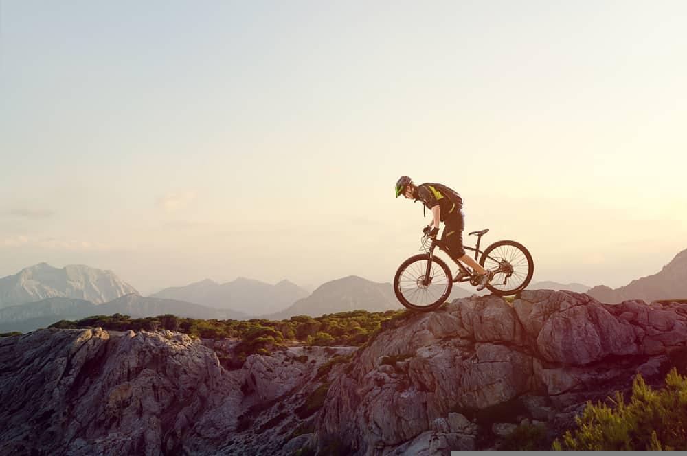 mountain biker on hard trail