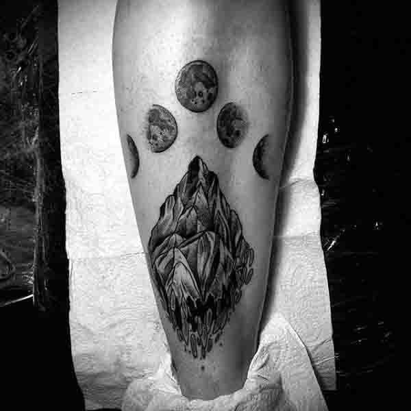 Mountain Rock With Moon Phases Mens Back Of Leg Tattoos