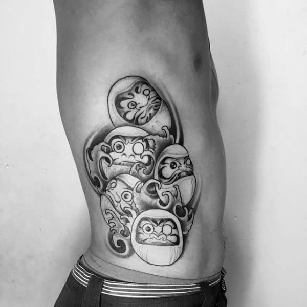 Multiple Daruma Dolls Mens Rib Cage Side Of Body Tattoo