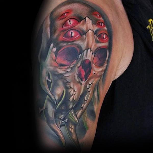Multiple Eyed Cthulhu Mens Arm Tattoo With Wateroclor Deisgn
