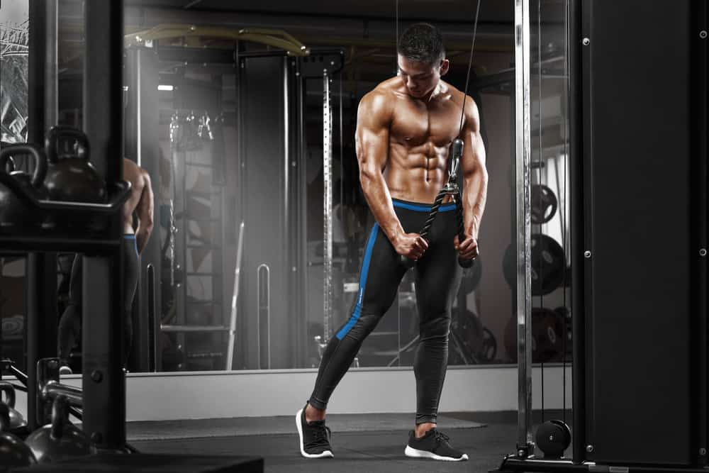 muscular man working out in gym
