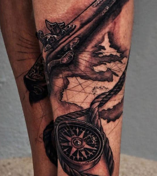 Muted Pistol And Compass Tattoo On Calves For Men