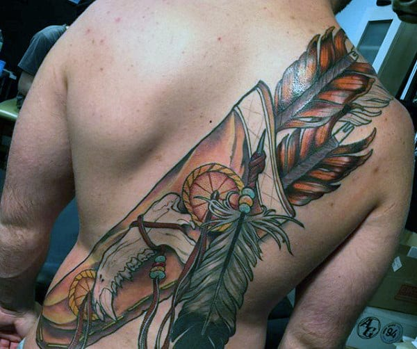 Native American Tools And Feathers Tattoo Mans Back