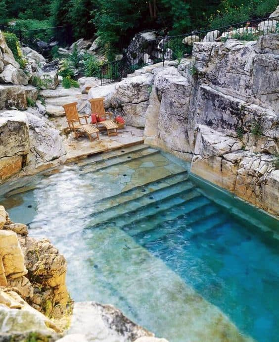 75 swimming pool designs for men cool ideas to soak in for Natural rock swimming pools