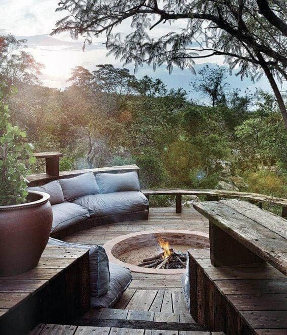 Nature Outdoor Wood Deck With Round Stone Fireplace Circle Design