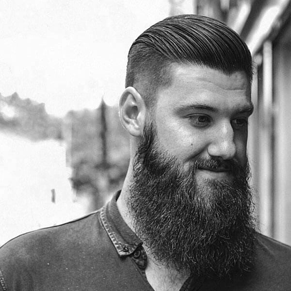 Neat Well Groomed Mens Undercut Slicked Back Hair With Beard