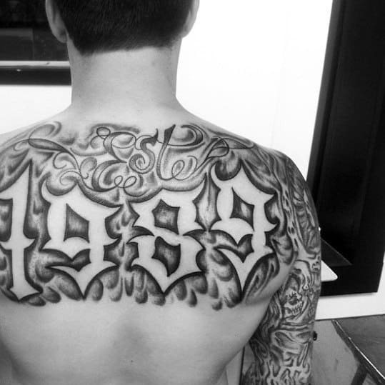 Negative Space 1989 Est Mens Back Tattoo Ideas