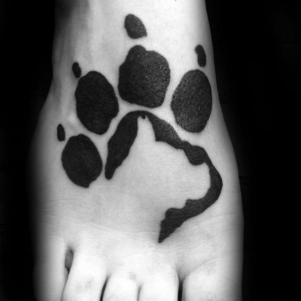 Negative Space Dog Paw Silhouette Tattoo On Mans Foot