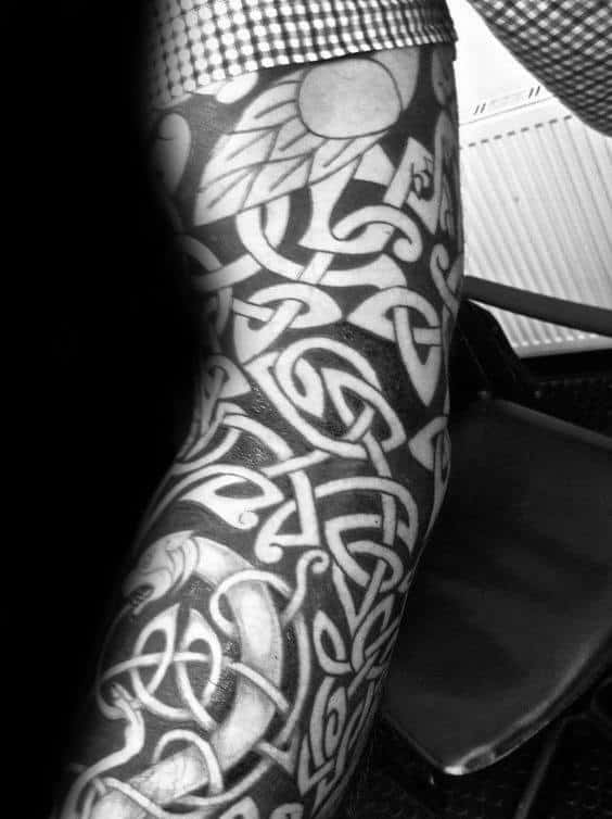 Negative Space Guys Black Ink Celtic Sleeve Tattoo