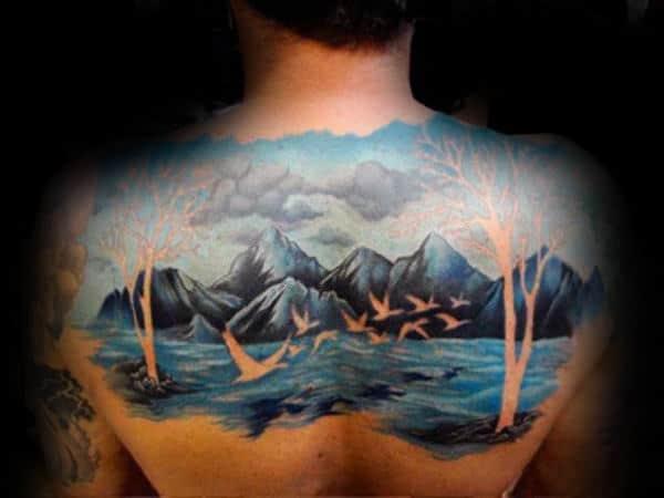 Negative Space Guys Blue Ink Landscape Back Tattoo