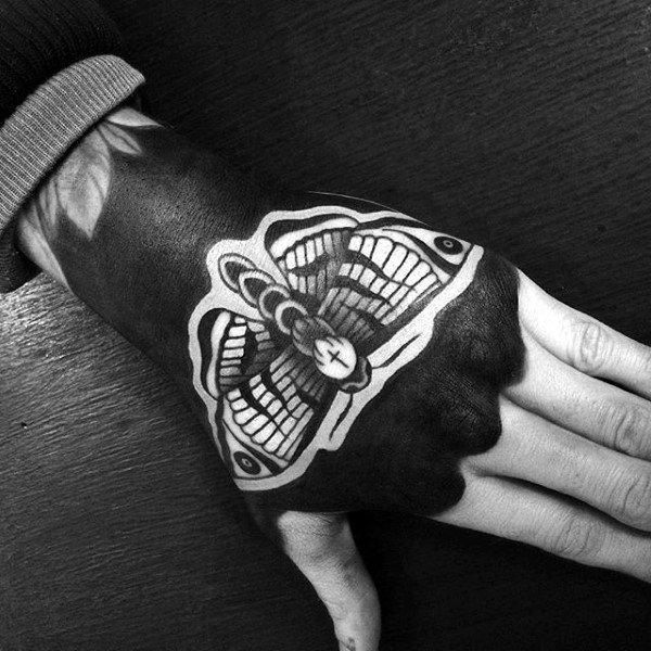 Negative Space Guys Moth Blackwork Hand Tattoo