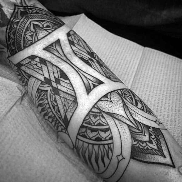 Negative Space Guys Pattern Gemini Inner Forearm Tattoo