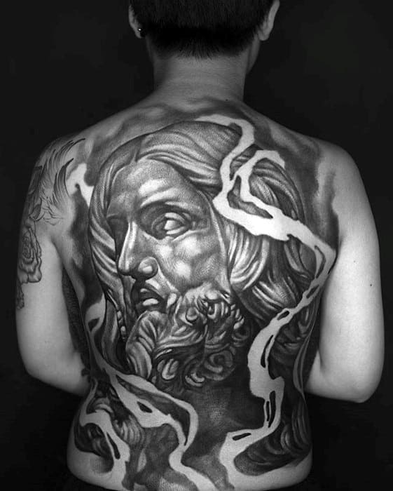 Negative Space Jesus Portrait Tattoo On Back For Males
