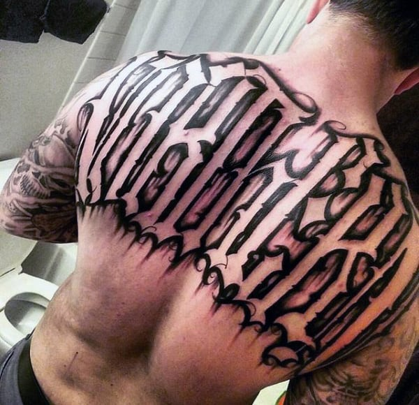 Negative Space Lettering Mens Old English Last Name Tattoo Design On Upper Back