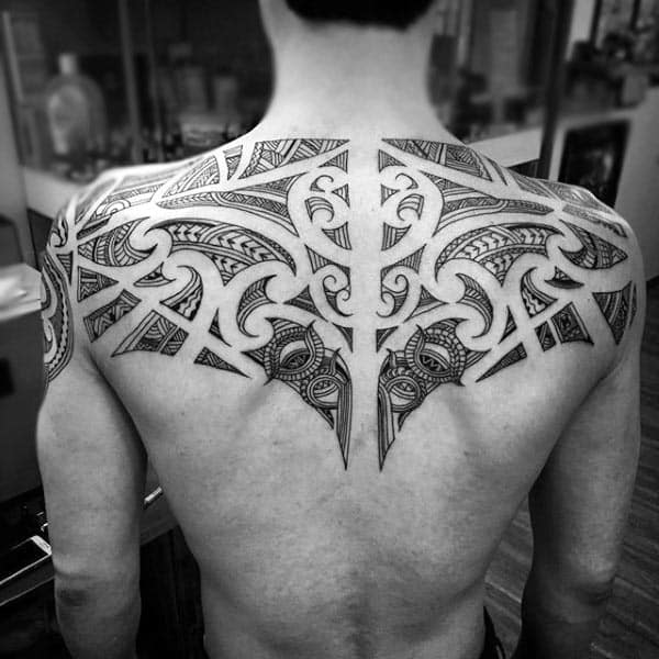 Negative Space Male Upper Back Tribal Tattoo Designs