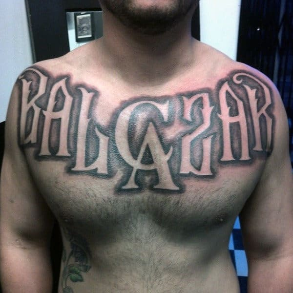 Negative Space Mens Last Name Upper Chest Tattoos