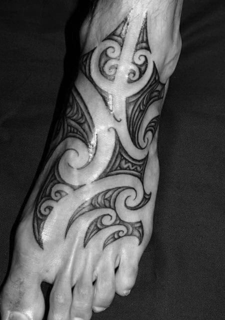 Negative Space Polynesian Foot Tattoos For Gentlemen