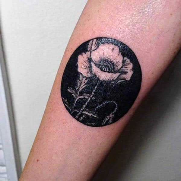 Negative Space Small Black Ink Mens Poppy Tattoo On Forearm