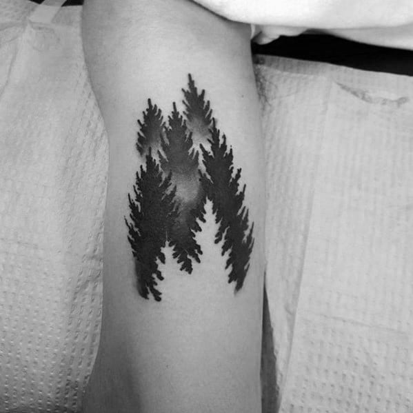 Negative Space Trees Forest Male Inenr Arm Bicep Tattoo With Simple Design