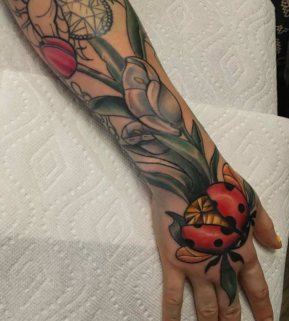 neotraditional-callalily-tulip-ladybug-tattoo-greenville_ghoul